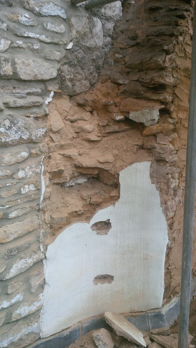 painted cement render over rubble and mud