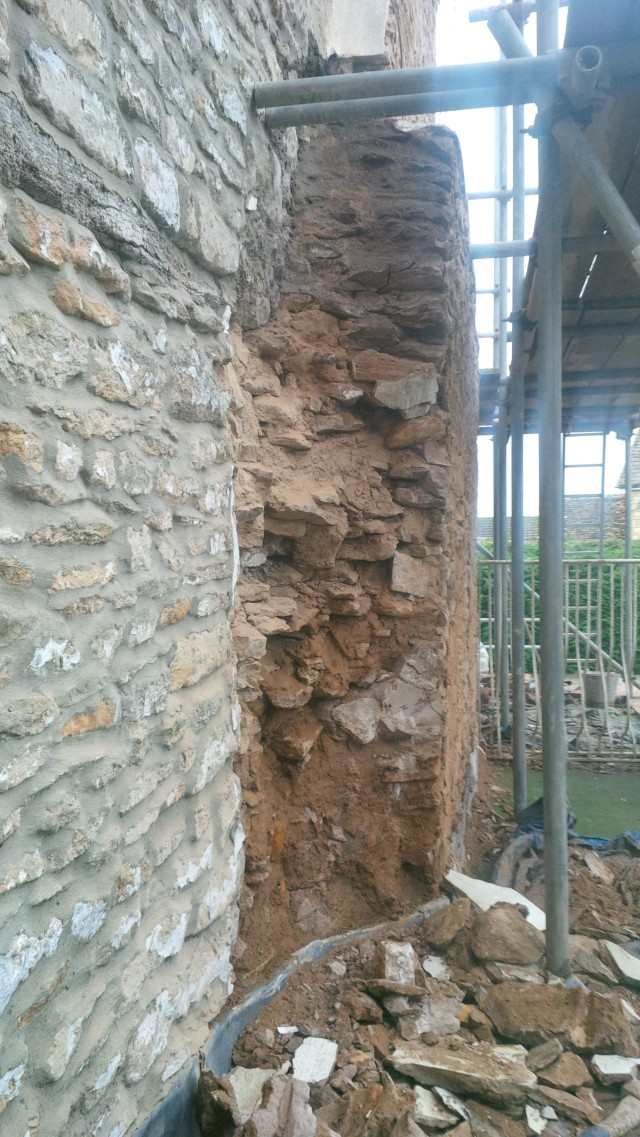 view of the left hand flank showing the ragged quality of the masonry